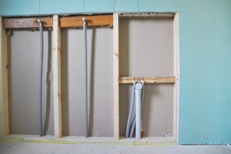 Bathroom water pipeline system with insulation and drain pipe renovation under drywall boards.